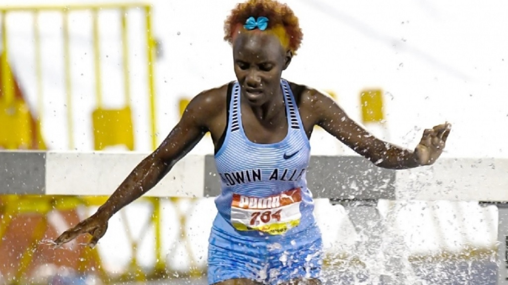 Aneisha Ingram of Edwin Allen High retains her title in the Girls' 2000m steeplechase open.