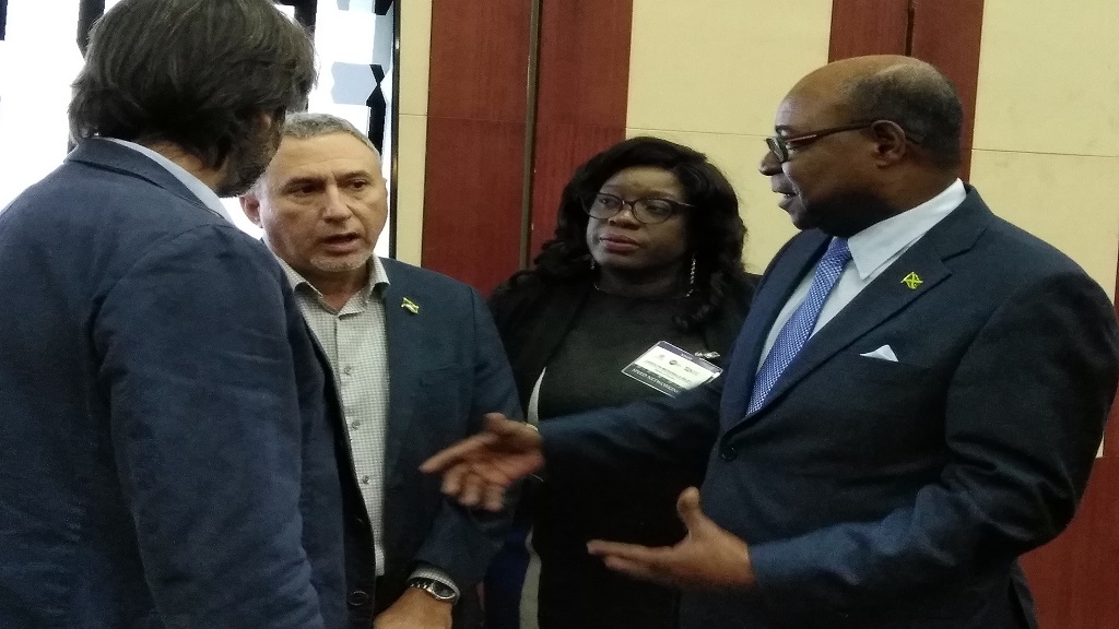 Tourism Minister, Edmund Bartlett (right), and Metry Seaga (second left), interacting with suppliers at the Tourism Linkages' Speed Networking event at the Montego Bay Convention Centre on Wednesday.