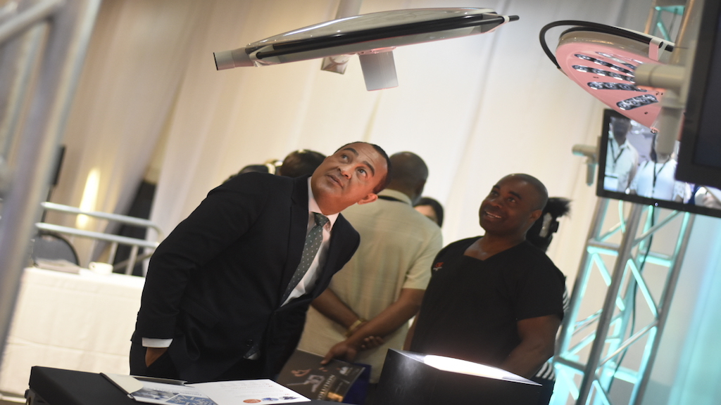 Health Minister Dr Christopher Tufton observes on of the equipment on display during the Caribbean Medical Devices Exhibition last week. (PHOTOS: Marlon Reid)