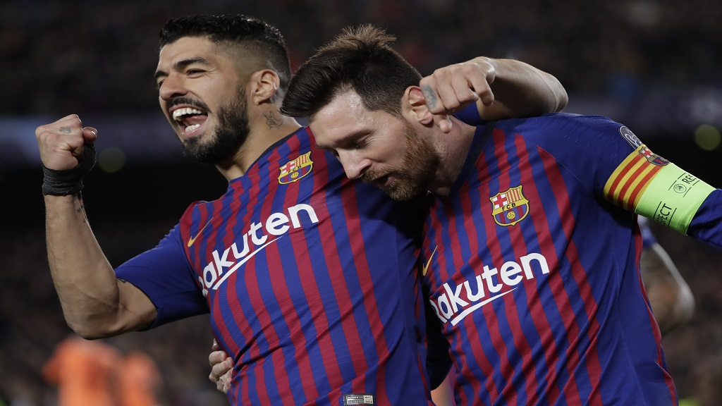 Barcelona's Lionel Messi, right and Barcelona's Luis Suarez celebrate after Messi scored his side's third goal during the Champions League round of 16, 2nd leg, football match against Olympique Lyon at the Camp Nou stadium in Barcelona, Spain, Wednesday, March 13, 2019.