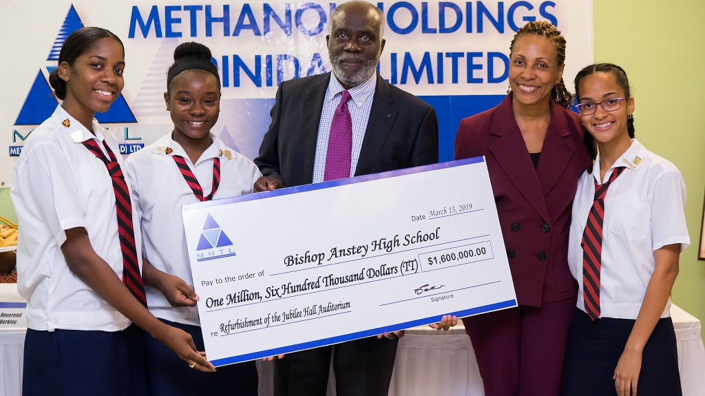 (Photo L-R: Dr. Euric Bobb, Chairman Methanol Holdings (Trinidad) Limited presents the cheque to Ms. Joanne Shurland, Principal of Bishop Anstey High School. Sharing in the moment are Anaya Price, Head Girl (from left) Jásher De Gannes, Deputy Head Girl and Shniya Hackshaw, Senior Prefect of Bishop Anstey High School.