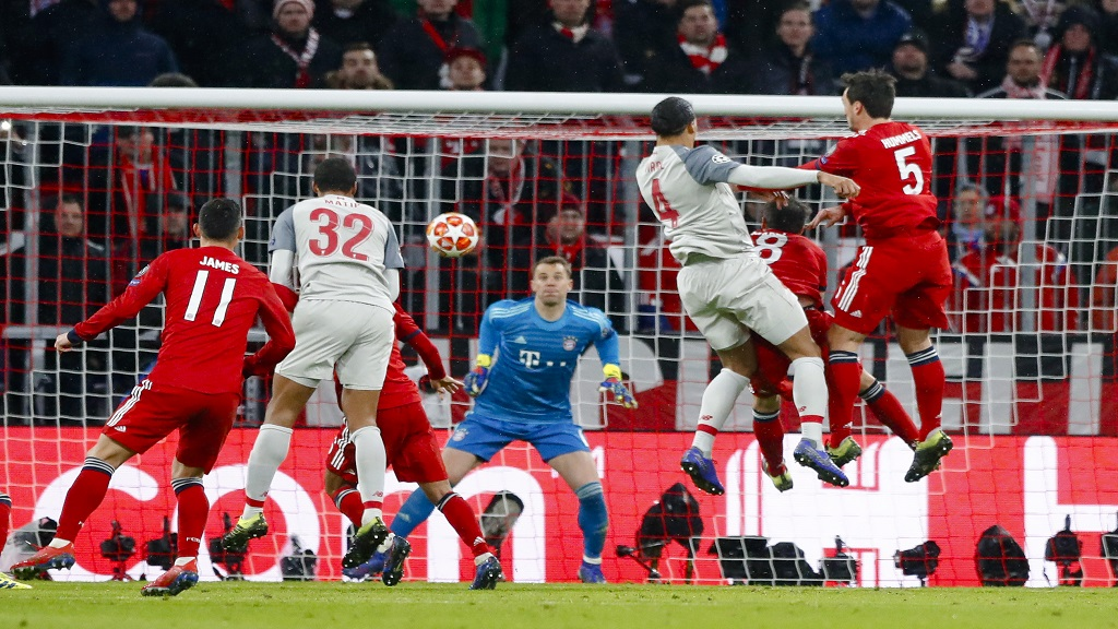 Liverpool defender Virgil Van Dijk, right, scores his side's second goal during the Champions League round of 16 second leg football match against Bayern Munich in Munich, Germany, Wednesday, March 13, 2019.