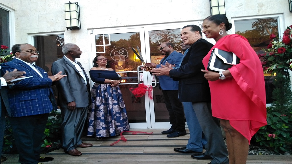 Tourism Minister, Edmund Bartlett (third right), in the company of other guests, prepares to cut the ribbon to officially open Grand-A-View Restaurant and Event Place in Montego Bay, St James last week.