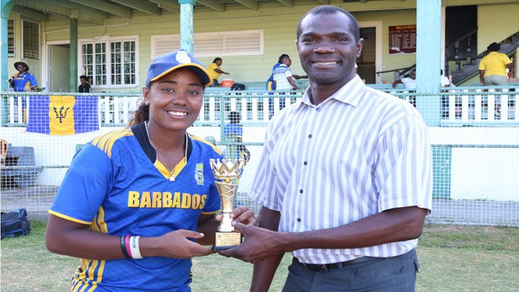 Hayley Matthews receive the Player of the Match award for leading Barbados to an easy victory over Jamaica in Round 3 of the Women's Super50 in Guyana on March 21, 2019.