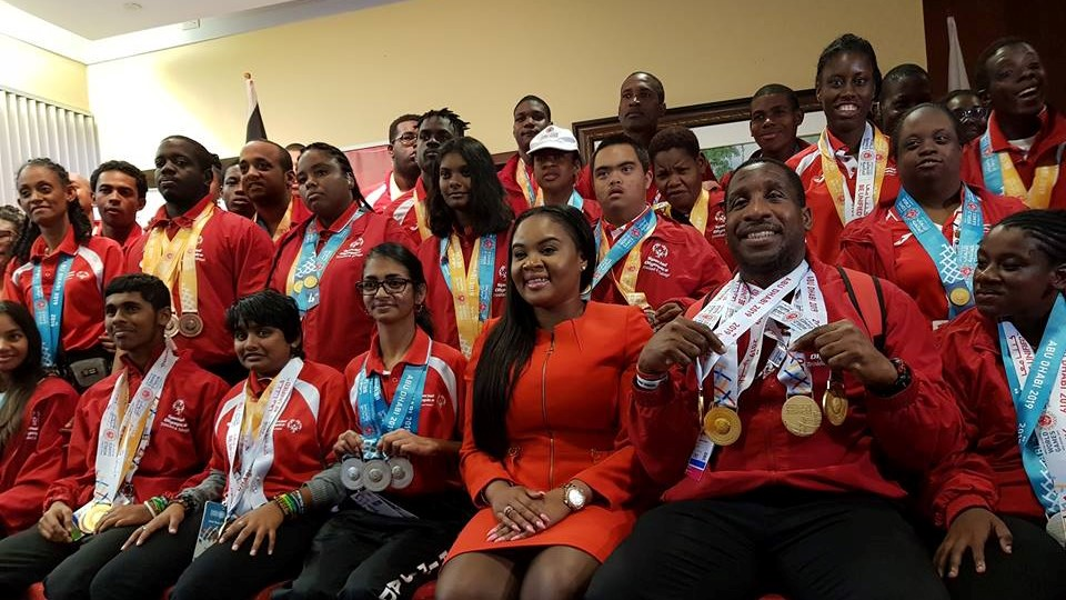 Minister of Sport and Youth Affairs Shamfa Cudjoe (third from right, bottom row) poses with members of the Special Olympics Trinidad and Tobago team (Ministry of Sport and Youth Affairs Facebook)