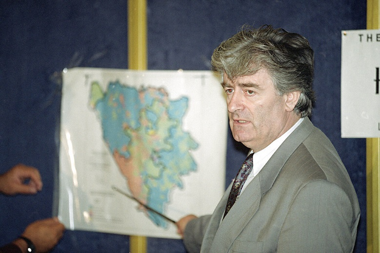 In this Aug. 25, 1992 file photo, Radovan Karadzic, Bosnian Serb leader in Bosnia-Herzegovina, indicates the Serb territories in Yugoslavia during a news conference in London. (AP Photo/Denis Paquin, File)