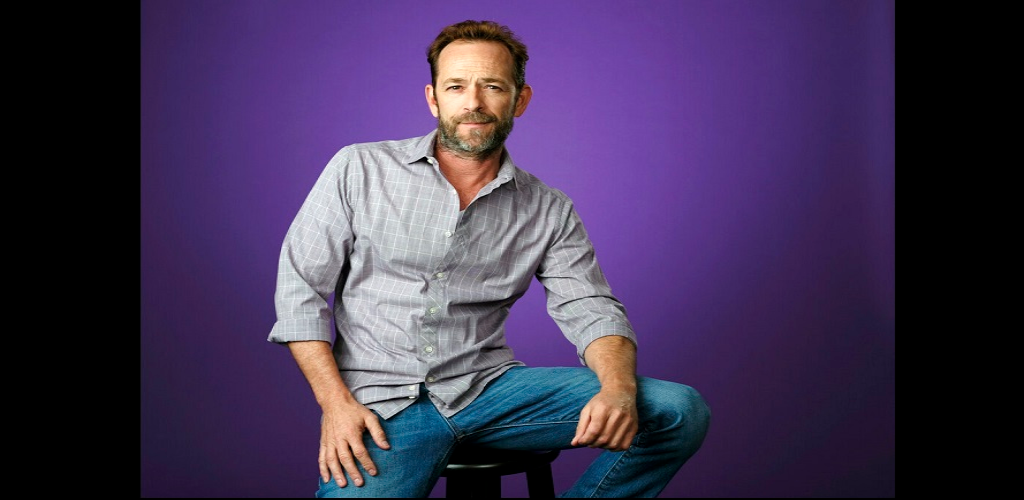 "FILE - In this Aug. 6, 2018, file photo, Luke Perry poses for a portrait during the 2018 Television Critics Association Summer Press Tour in Beverly Hills, Calif. A publicist for Perry says the ""Riverdale"" and ""Beverly Hills, 90210"" star has died."