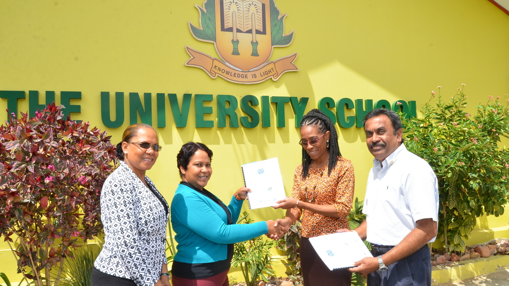 Second from right:  Odessa Vincent Brown, Principal of The University School receives an EarlyAct™ Manual from Maria Mohammed-Maharaj, President of the Rotary Club of St Augustine.  Looking on are Stacy Richards-Kennedy, Chairman of the School Council and Vishnu Balroop, Past President and EarlyAct™ Co-ordinator, Rotary Club of St Augustine.