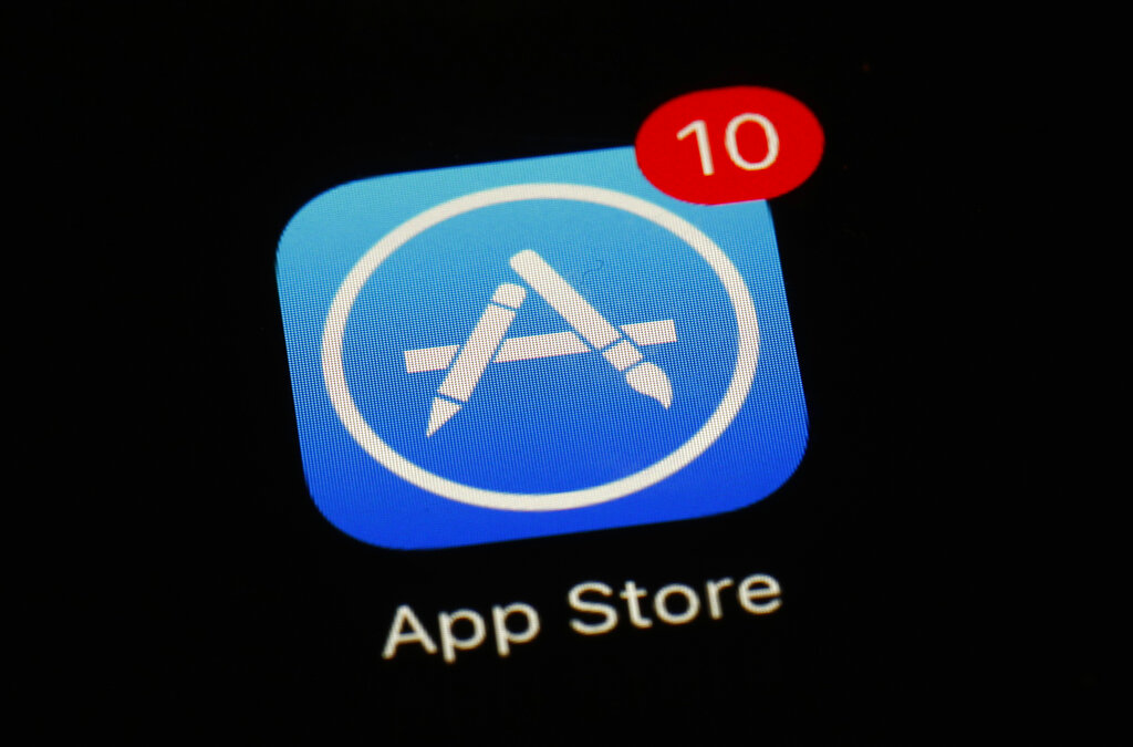 This March 19, 2018, file photo shows Apple's App Store app in Baltimore. As its iPhone sales slip, Apple has been touting its growing digital-services business as the engine that will keep profits up. (AP Photo/Patrick Semansky, File)
