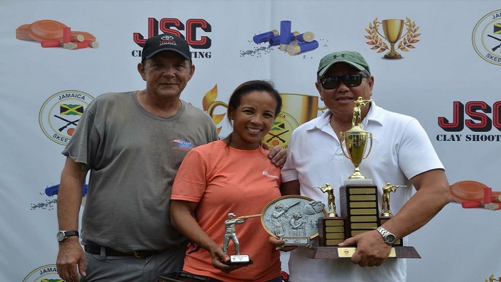 Robert Yap Foo (right) and Wendy McMaster (centre) pose with the main prizes following a Jamaica Skeet Club's Sporting Clays Classic last year. At left is Evan Thwaites, president of the Jamaica Skeet Club.