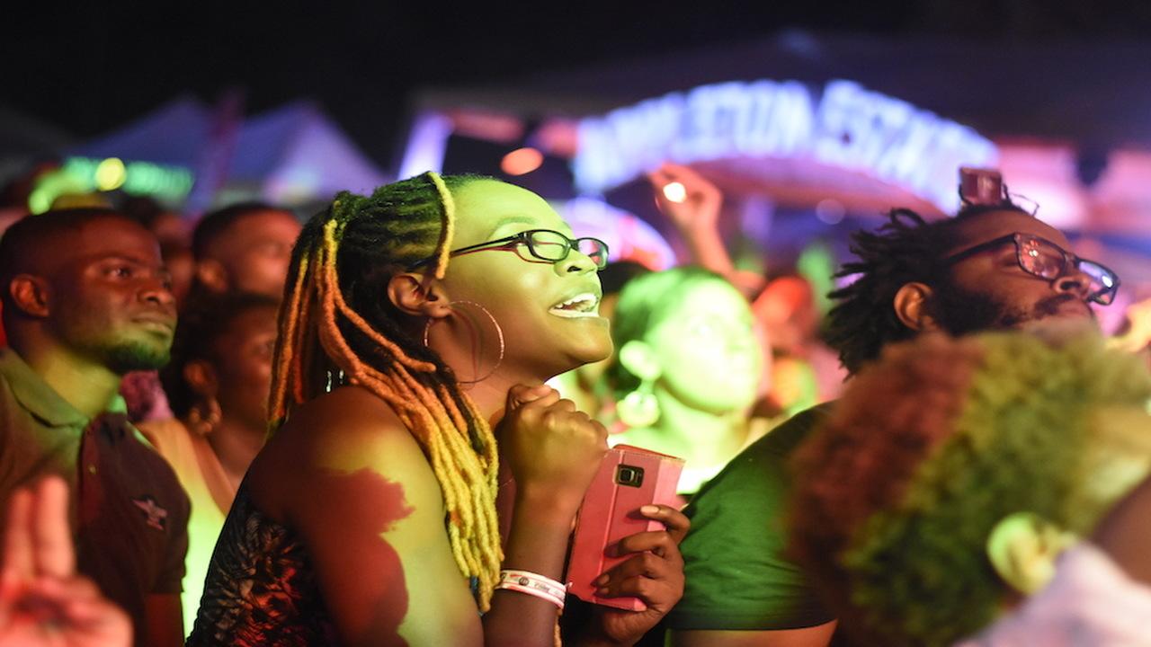 Patrons enjoy a performance by reggae singer Jesse Royal during the Jamaica Rum Festival on Sunday. (PHOTOS: Marlon Reid)