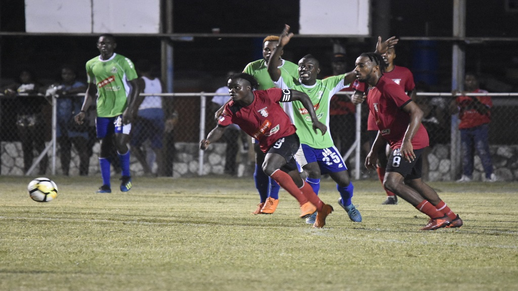 Montego United (green top) and Arnett Gardens in action in a recent Red Stripe Premier League game.