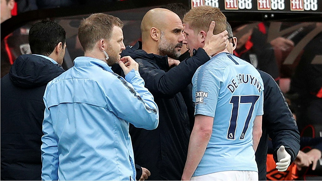 Manchester City manager Pep Guardiola consoles injured player Kevin De Bruyne as he leaves the pitch during the English Premier League football match against Bournemouth at the Vitality Stadium, in Bournemouth, England, Saturday March 2, 2019.