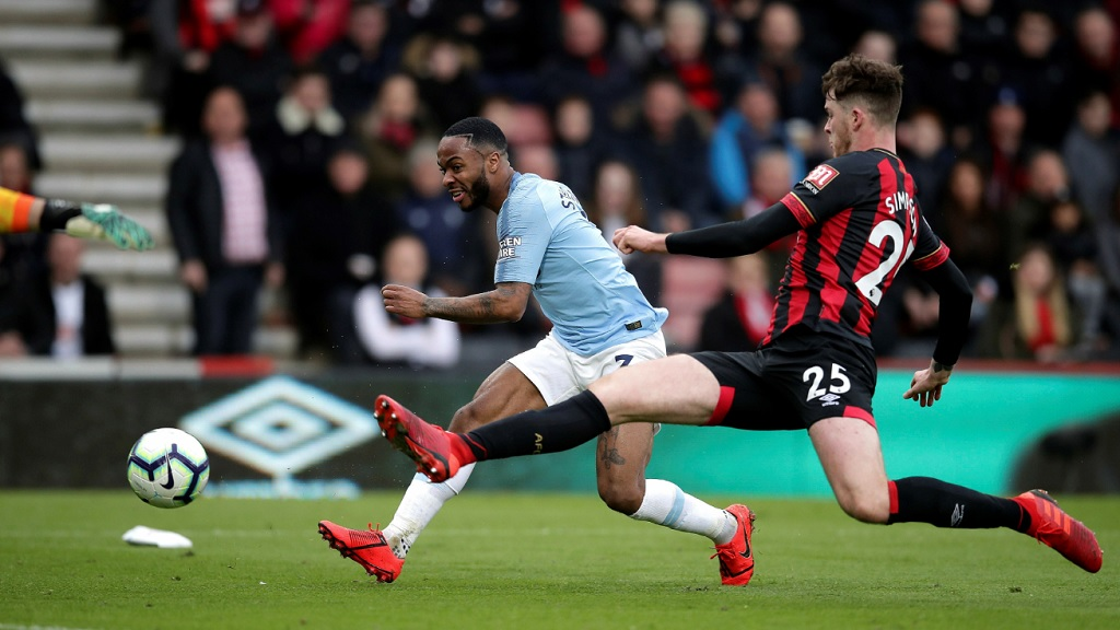 Manchester City's Raheem Sterling, left and Bournemouth's Jack Simpson battle for the ball, during their English Premier League football match at the Vitality Stadium, in Bournemouth, England, Saturday March 2, 2019.