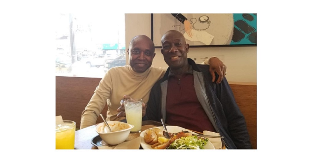 Prime Minister Dr Keith Rowley (right) is all smiles with his doctor (left) as they share a meal at a restaurant in California.