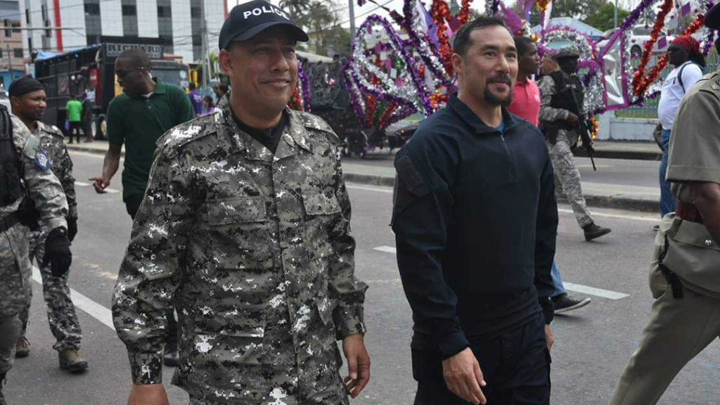 Police Commissioner Gary Griffith wears digital camouflage while on a walkabout with National Security Minister Stuart Young during Carnival celebrations.