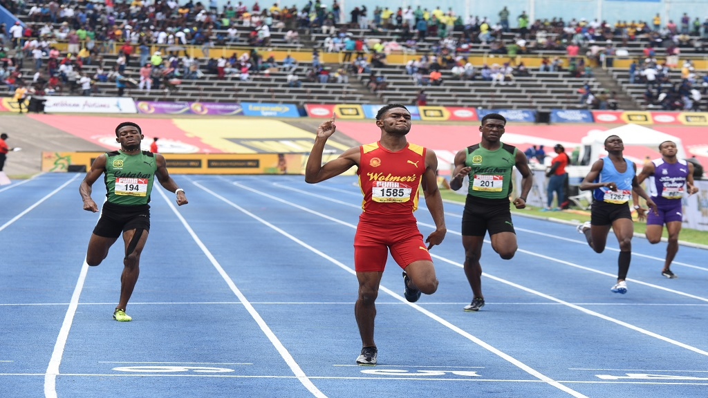 Jeremy Farr of Wolmer's Boys School beats the Calabar pair of Christopher Taylor (left) and  Evaldo Whitehorne (right)  in the Boys' Class 1 400m at the  Boys' and Girls' Athletics Championships at the National Stadium on Saturday, March 30, 2019.