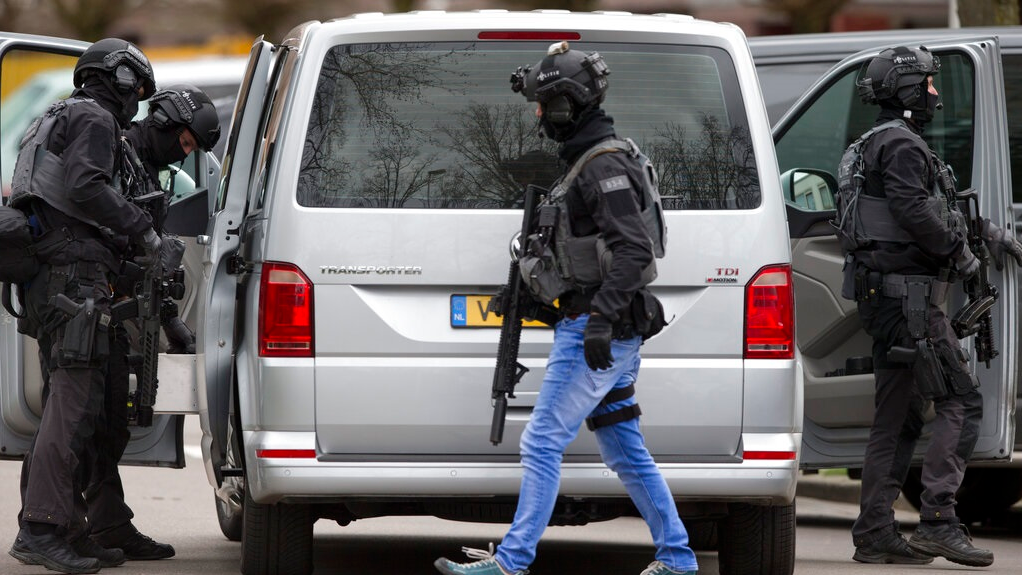 Dutch counter terrorism police prepare to enter a house after a shooting incident in Utrecht, Netherlands, Monday, March 18, 2019. A gunman killed three people and wounded nine others on a tram in the central Dutch city of Utrecht, sparking a manhunt that saw heavily armed officers with sniffer dogs zero in on an apartment building close to the shooting. (AP Photo/Peter Dejong)