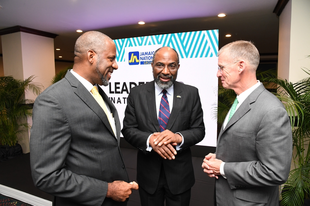Dr Wayne Henry (left), director-general of the Planning Institute of Jamaica and chair of the luncheon; Earl Jarrett, CEO, The Jamaica National Group and Retired US Army General, Stanley McChrystal, in conversation following a luncheon on leadership.