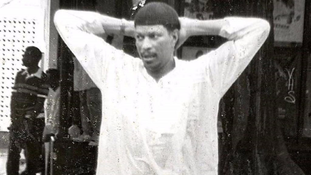 Photo: Leader of Jamaat-al-Muslimeen, Yasin Abu-Bakr, is detained after the 1990 coup.