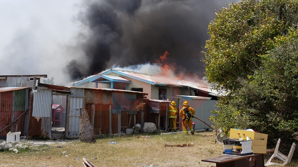 Fire officers trying to extinguish the blaze at the second home.