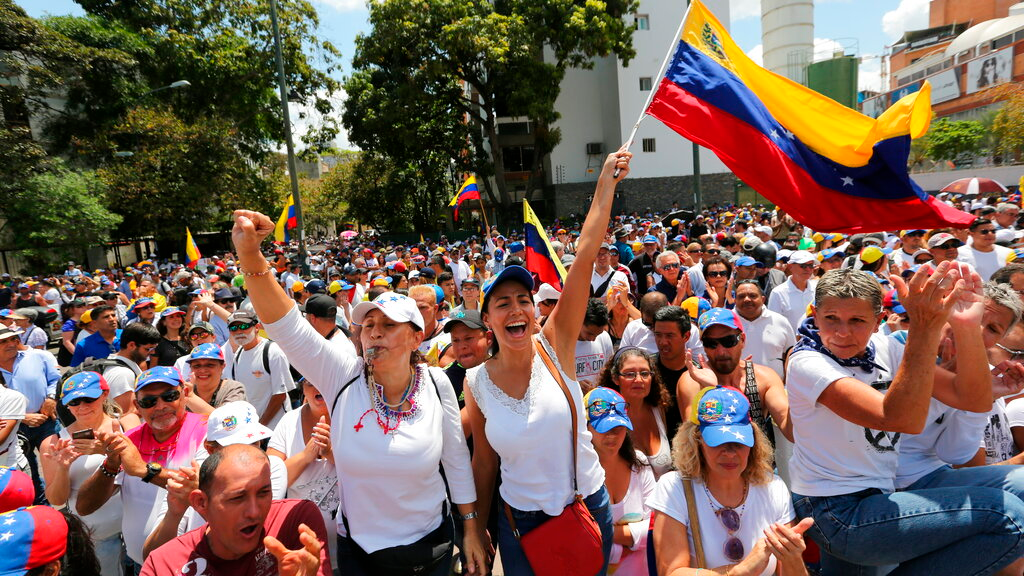 Anti-government protesters rally to demand the resignation of Venezuelan President Nicolas Maduro in Caracas, Venezuela, Monday, March 4, 2019. (AP Photo/Fernando Llano)