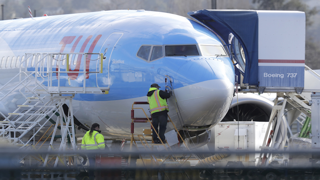 A worker stands on a platform near a Boeing 737 MAX 8 airplane being built for TUI Group at Boeing Co.'s Renton Assembly Plant Wednesday, March 13, 2019, in Renton, Washington. (PHOTO: AP)