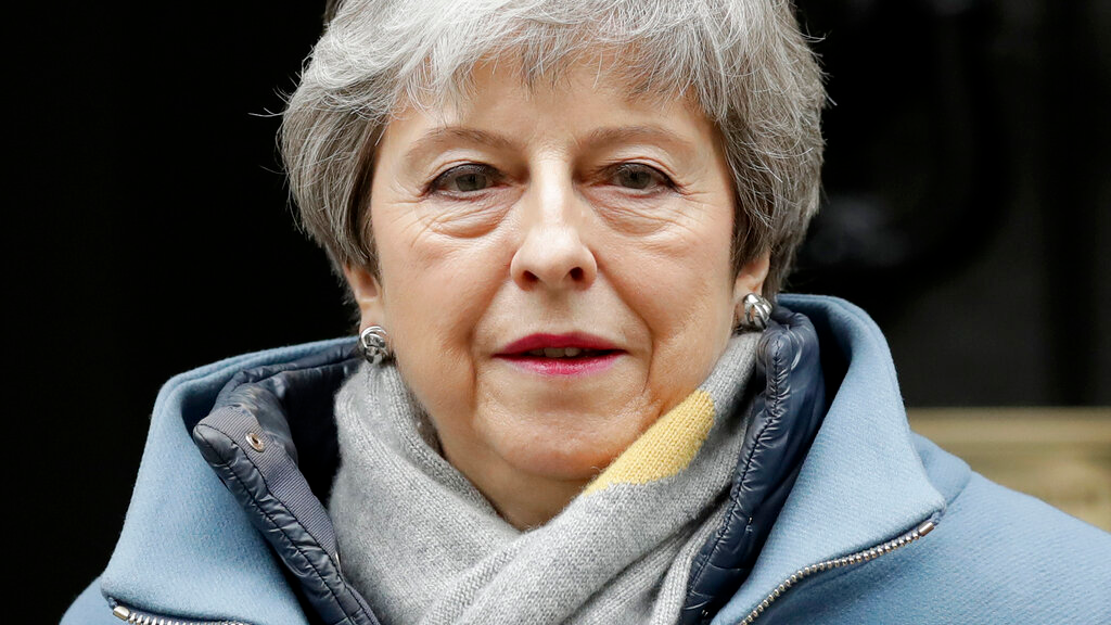 Britain's Prime Minister Theresa May leaves 10 Downing Street to attend the weekly Prime Ministers' Questions session, at parliament in London, Wednesday, March 20, 2019. (AP Photo/Matt Dunham)
