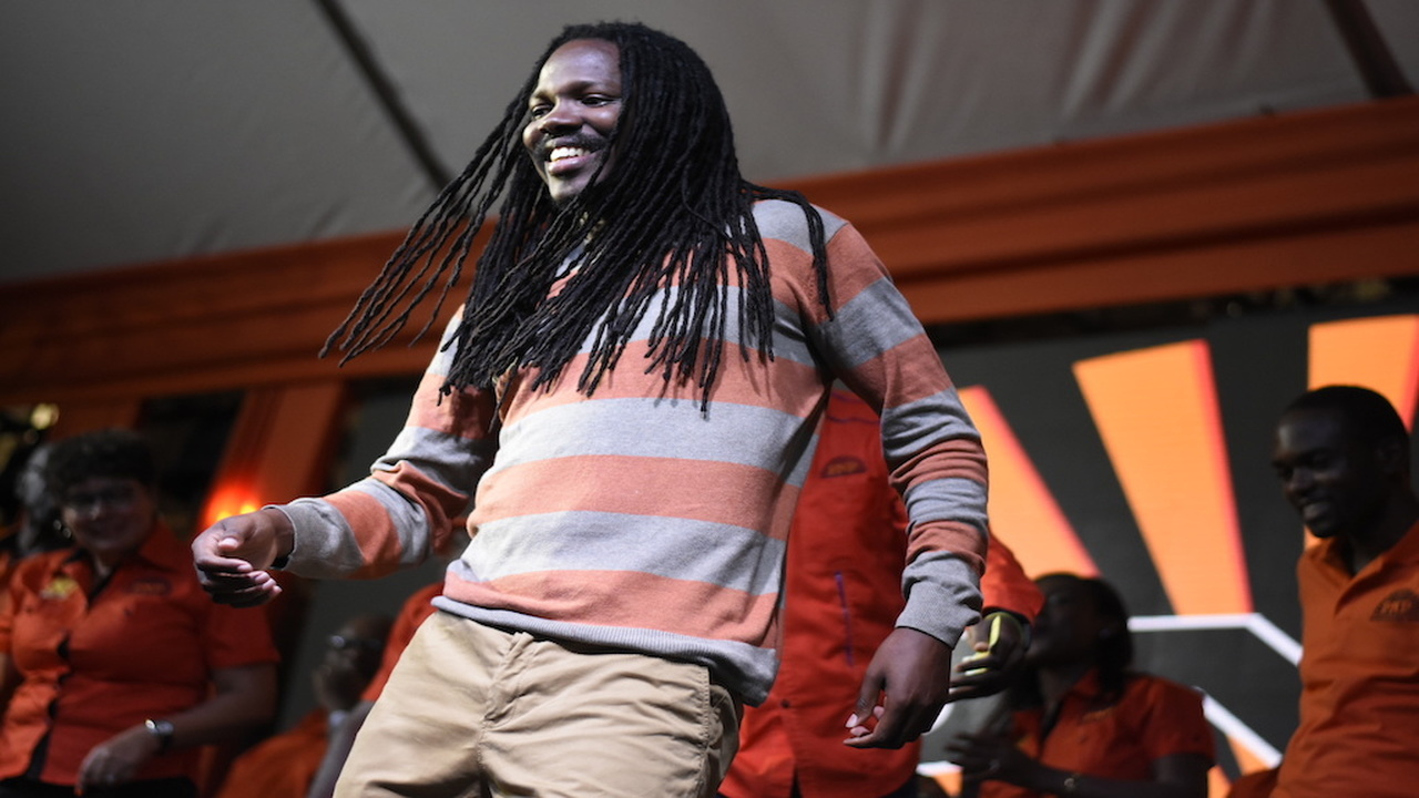 Damion Crawford dances on stage during a People's National Party at Port Antonio Square on Sunday. (PHOTO: Marlon Reid)