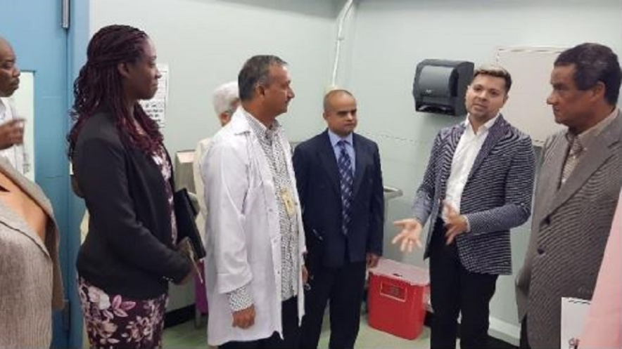 Dr Vishwanath Partapsingh, Chief Medical Officer (Ag) (second from right) makes a point to patients and the medical team while on tour of the new Arima Wound Care Clinic. Looking on is General Manager Primary Care, Dr Abdul Hamid and Deputy Chairman of the NCRHA, Elvin Edwards.