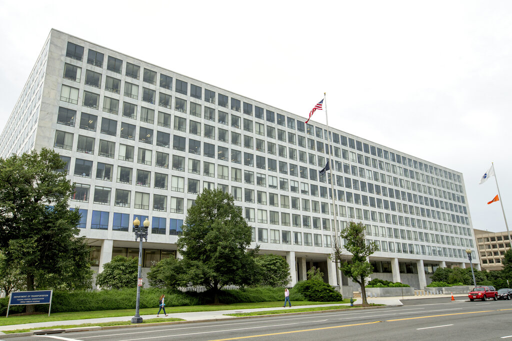 This Friday, June 19, 2015 file photo shows the Department of Transportation Federal Aviation Administration building, in Washington. For more than six decades, the Federal Aviation Administration has relied on employees of airplane manufacturers to do government-required safety inspections as planes are being designed or assembled. (AP Photo/Andrew Harnik, File)