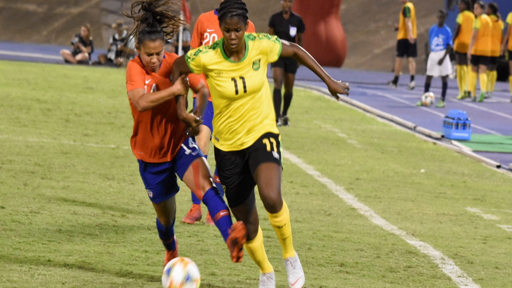 Jamaica's Khadija Shaw moves ahead of a Chile defender during their friendly international football game at the National Stadium in Kingston on Thursday, February 28, 2019. (PHOTOS: Marlon Reid).
