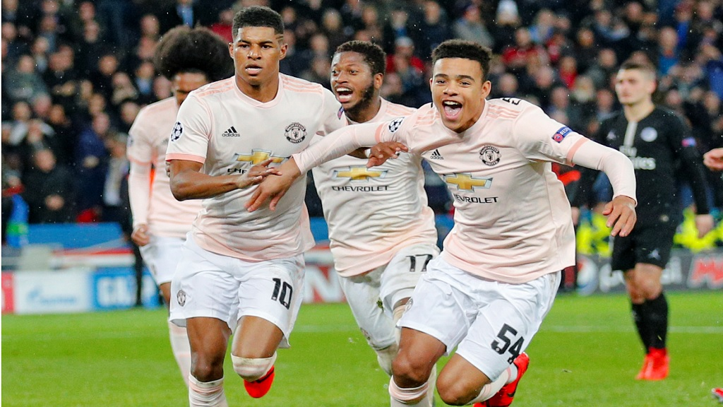 Manchester United's Marcus Rashford, left, celebrates after scoring his side's third goal during the Champions League round of 16, second leg football match against Paris Saint Germain at the Parc des Princes stadium in Paris, France, Wednesday, March. 6, 2019.