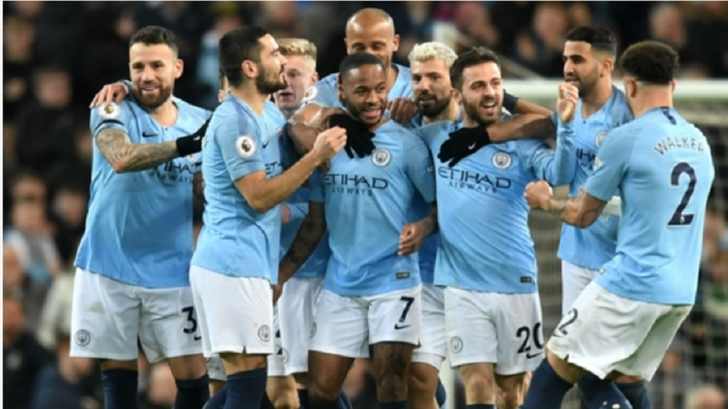 Raheem Sterling is congratulated after scoring one of his three goals against Watford.