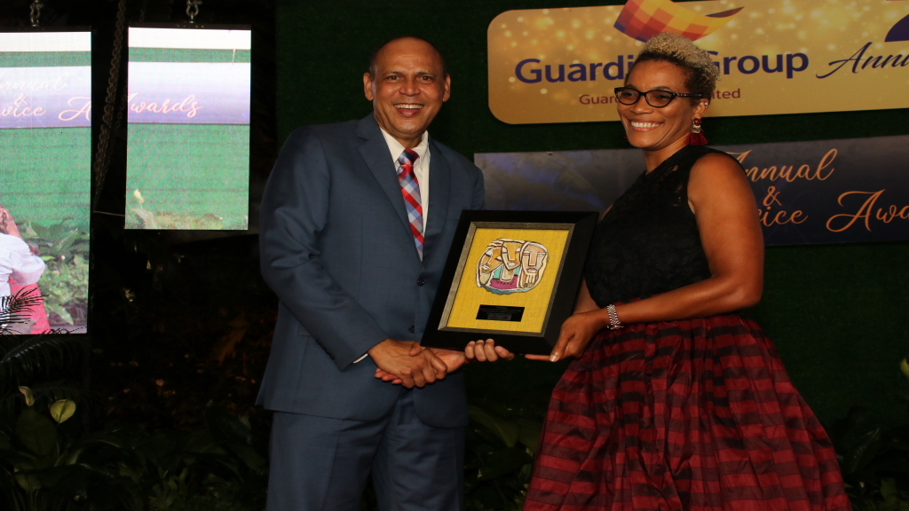 Eric Hosin, President, Guardian Life Limited, expressed appreciation to the scores of men and women who have remained with the company since it was launched and commended their unwavering loyalty and commitment. Photo: Llewellyn Wynter