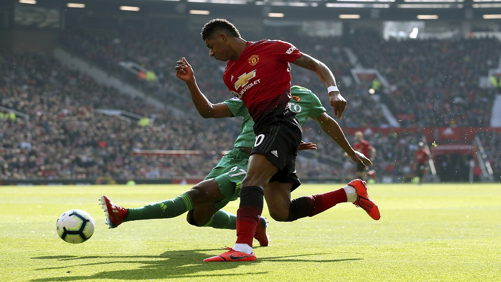 Watford's Christian Kabasele, background and Manchester United's Marcus Rashford battle for the ball, during the English Premier League football match at Old Trafford, in Manchester, England, Saturday March 30, 2019.
