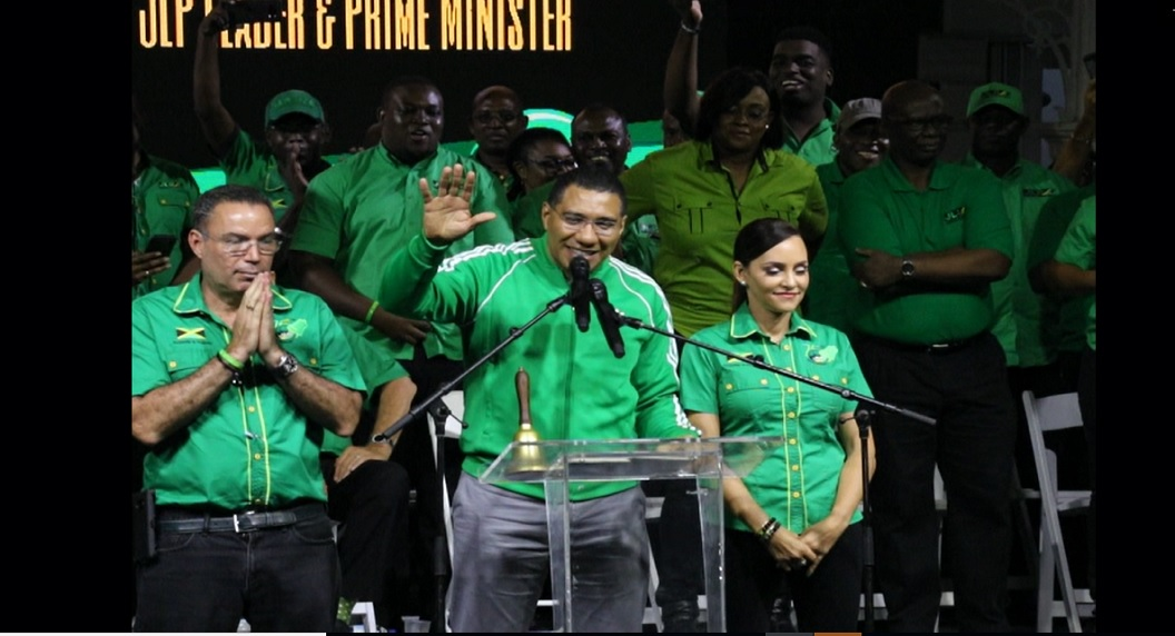 Prime Minister Andrew Holness (centre), pictured last Friday with Daryl and Ann-Marie Vaz, had previously announced Monday, March 25 as the date for the polls and Friday, March 8, for Nomination Day.
