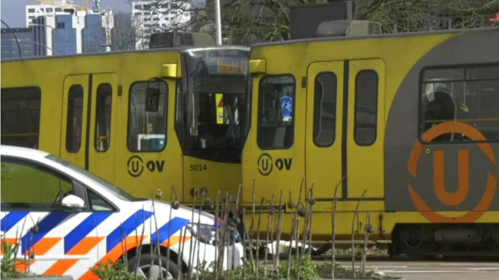 "In this image taken from video, a body lays next to a tram as emergency services attend the scene of a shooting in Utrecht, Netherlands, Monday March 18, 2019. Police in the central Dutch city of Utrecht say on Twitter that ""multiple"" people have been injured as a result of a shooting in a tram in a residential neighborhood. (AP Photo)"