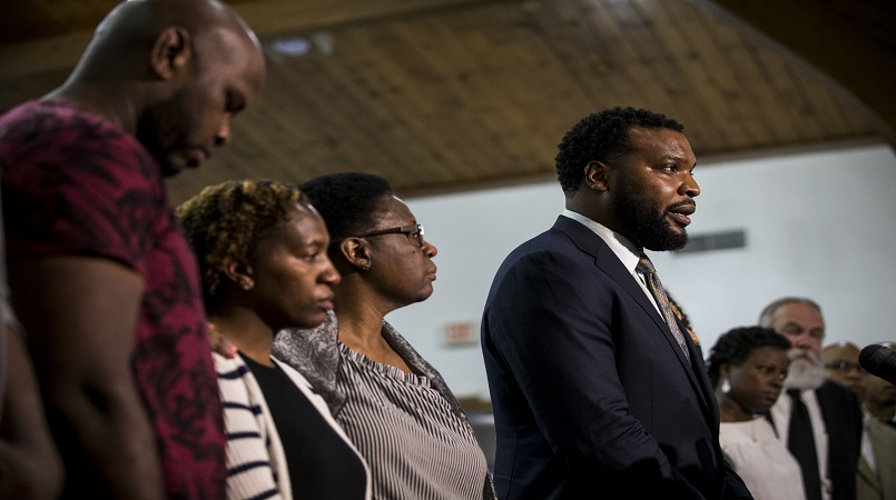 Jean's family lawyer Lee Merritt gives talks to members of the press following a prayer vigil for Botham Shem Jean at the Dallas West Church of Christ on Saturday, Sept. 8, 2018 in Dallas.(Shaban Athuman/The Dallas Morning News via AP)