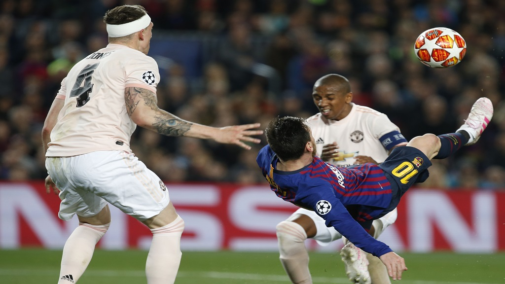 Barcelona forward Lionel Messi tries to score with a bicycle kick during the Champions League quarterfinal, second leg, football match against Manchester United at the Camp Nou stadium in Barcelona, Spain, Tuesday, April 16, 2019.