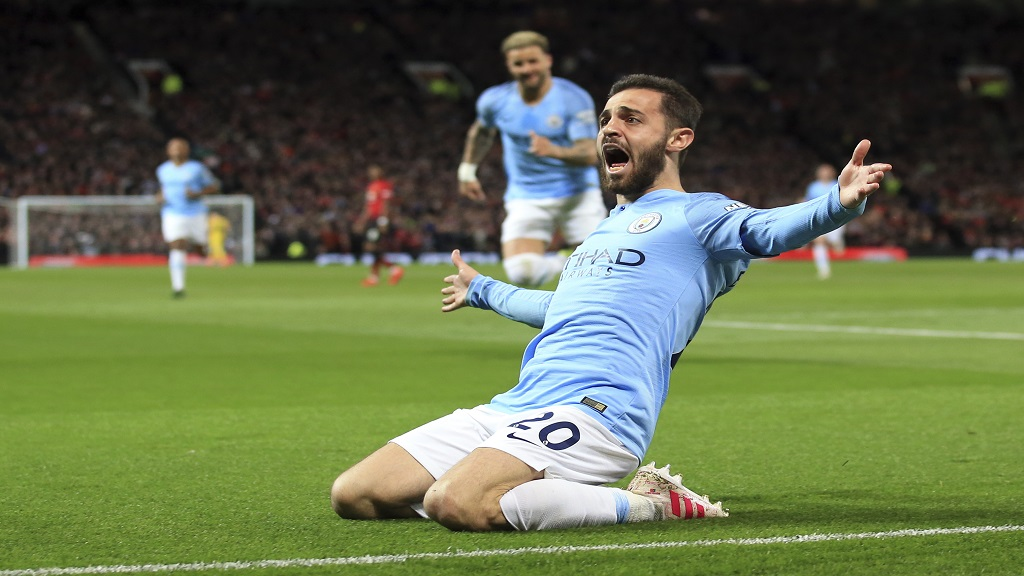 Manchester City's Bernardo Silva celebrates after scoring the opening goal during the English Premier League football match against Manchester United at Old Trafford Stadium in Manchester, England, Wednesday April 24, 2019.