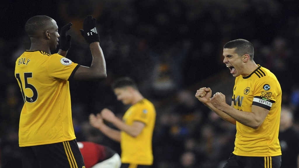 Wolverhampton's Conor Coady, right, and Willy Boly, left, celebrate at the end of the English Premier League football match between against Manchester United at the Molineux Stadium in Wolverhampton, England, Tuesday, April 2, 2019.