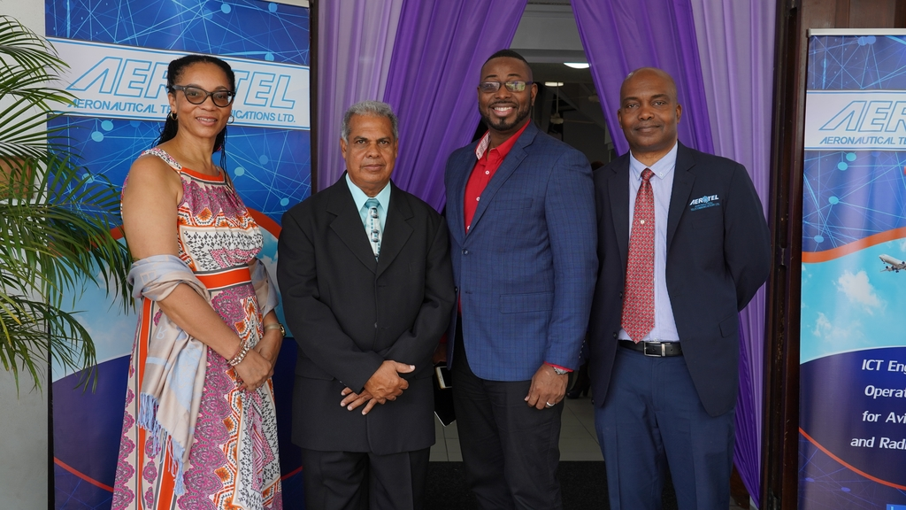 Aeronautical Telecommunications Limited, AEROTEL General Manager, Howard Armstrong (right) poses alongside (from left) the company's secretary, Marlene McLean and Directors of the board, Linvole Stephens and Ewan Simpson after the 40th anniversary church service.