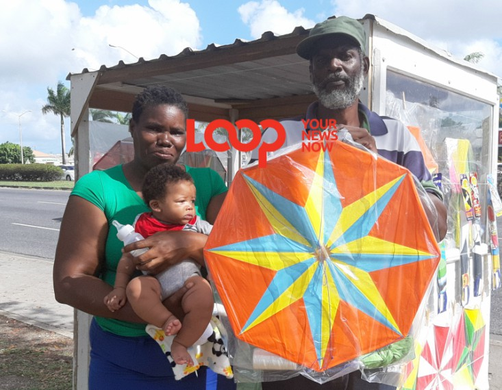 Gillian and Ronald Layne displaying kites they made for the season.