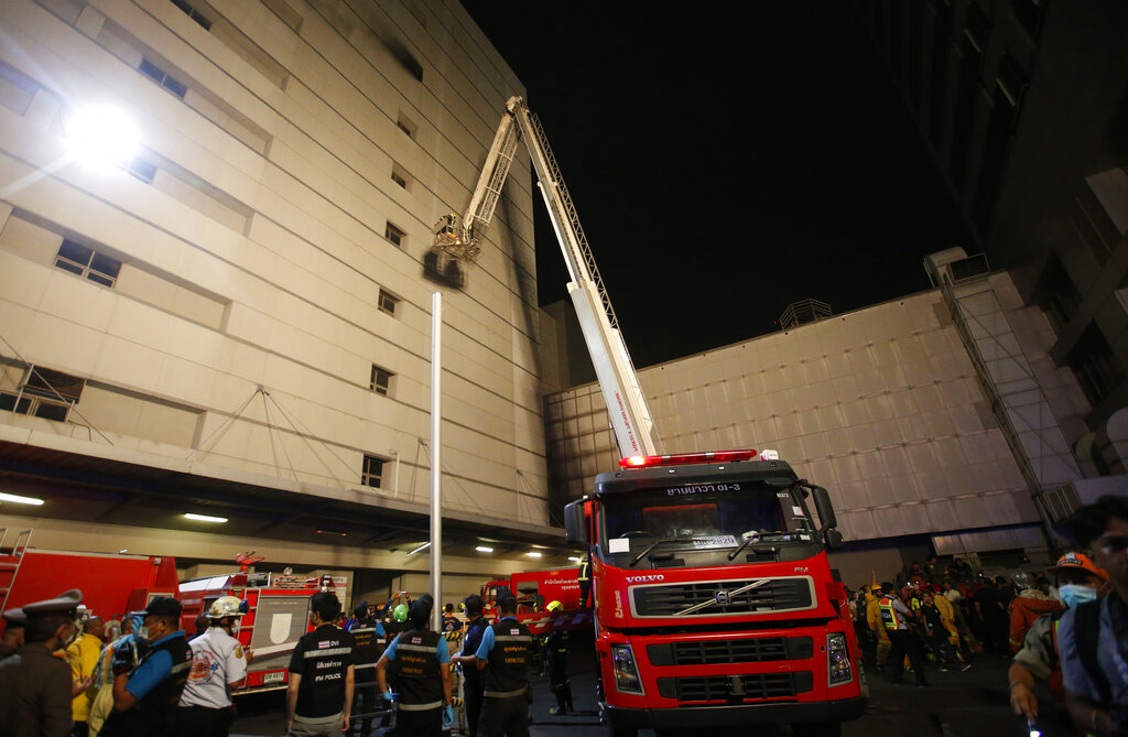 Emergency rescue teams gather outside of the Central World mall complex, Wednesday, April 10, 2019, in downtown Bangkok, Thailand. (AP Photo/Sakchai Lalit)