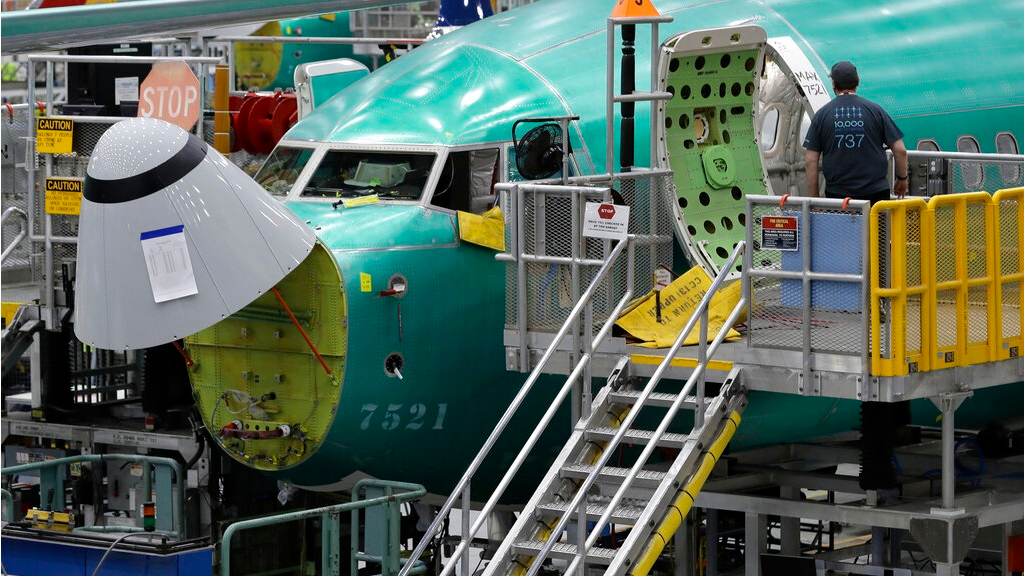 FILE - In this March 27, 2019, file photo, a worker enters a Boeing 737 MAX 8 airplane during a brief media tour of Boeing's 737 assembly facility in Renton, Wash. A published report says pilots of an Ethiopian airliner that crashed followed Boeing's emergency steps for dealing with a sudden nose-down turn but couldn't regain control. (AP Photo/Ted S. Warren, File)
