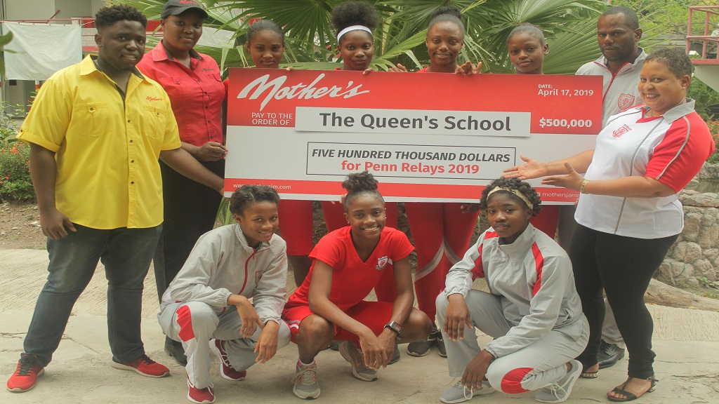Junior Brand Manager of Mother's Canteens, Tahji Whittaker (left), hands over J$500,000 to the members of The Queen's School delegation ahead of the 2019 staging of the Penn Relay.
