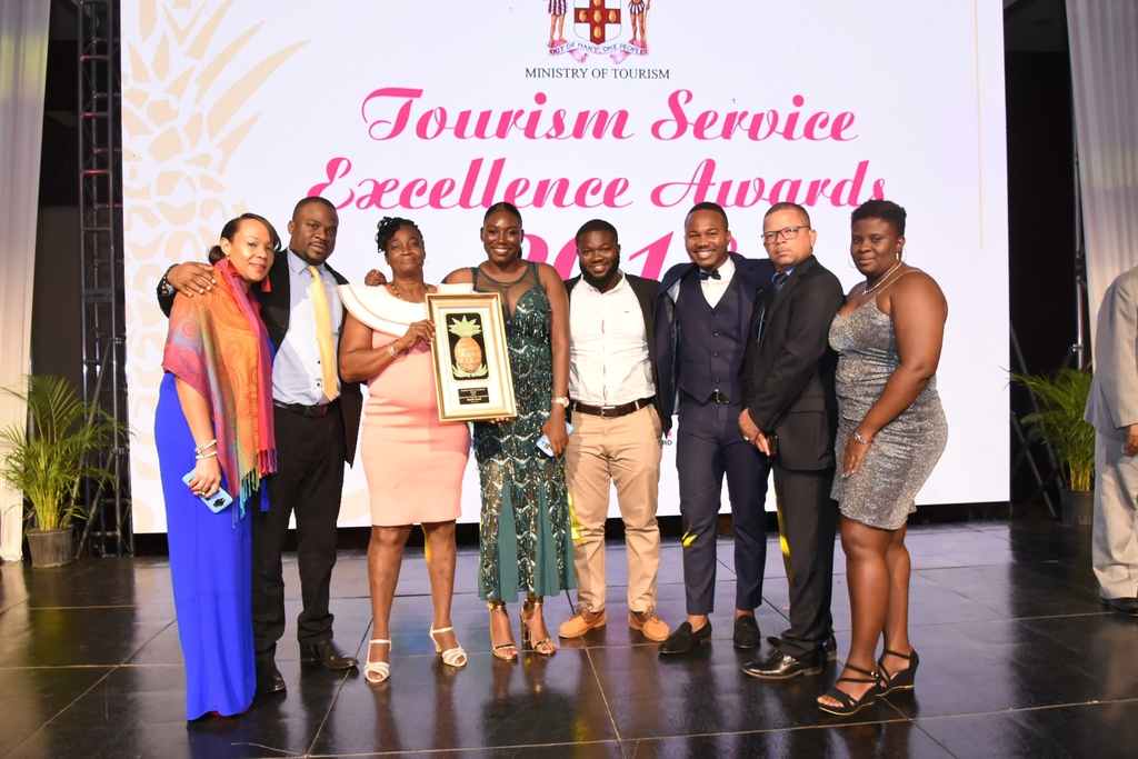 O'Shane Ellis (third right), General Manager, Joy Spence Appleton Estate Rum Experience (JS-AERE) and members of the JS-AERE team, display the Tourism Service Excellence Award for the South Coast region, during the 2019 awards ceremony.