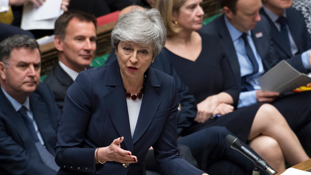 Britain's Prime Minister Theresa May stands to talk to lawmakers inside the House of Commons parliament in London Wednesday March 27, 2019. (Jessica Taylor/House of Commons via AP)
