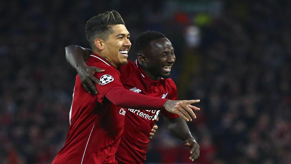 Liverpool's Naby Keita celebrates with Roberto Firmino, left, after scoring the opening goal during the Champions League quarterfinal, first leg, football match against FC Porto at Anfield Stadium, Liverpool, England, Tuesday April 9, 2019.